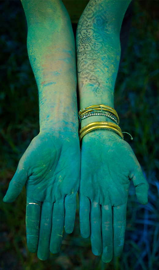 Samantha's outspread green and blue hands