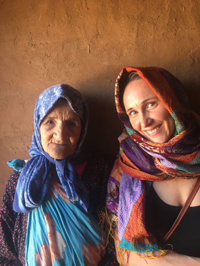 Samantha sitting with a Berber woman in Morrocco.