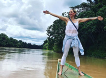 Sam standing on a boat in the Amazon