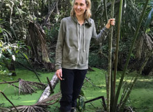 Sam standing in the swampy Amazon river
