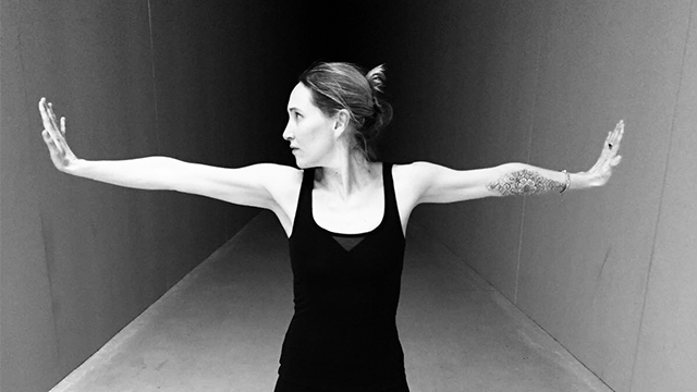 Black and white photo of Samantha holding arms out